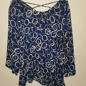 Navy blue blouse with white circles